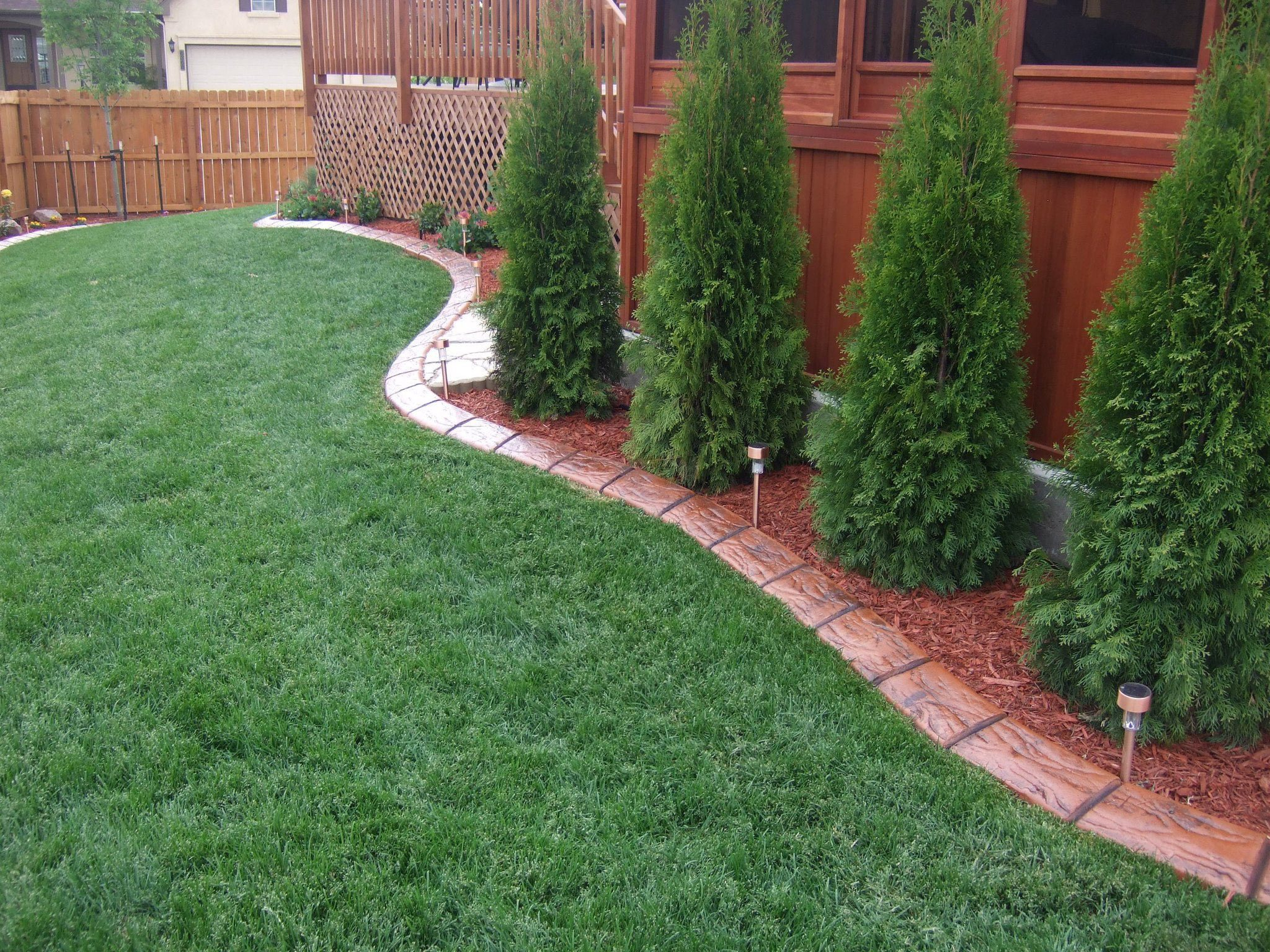 Decorative concrete Curbing with trees and plants.
